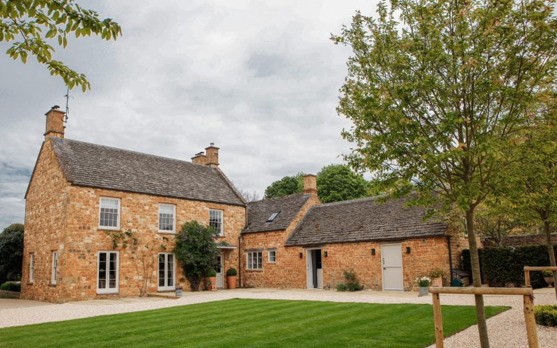 Redevelopment by Corinium Construction: External shot of 19th century Oxfordshire farmhouse in the Cotswolds